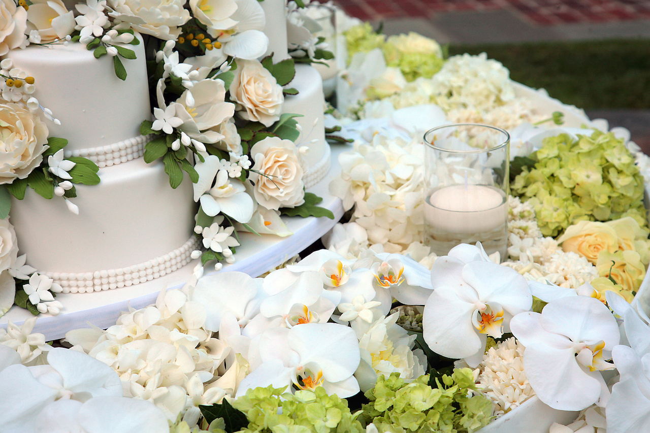 Le Fleur created arrangements of cream and white flowers including hydrangeas and orchids, the bride's favorites.