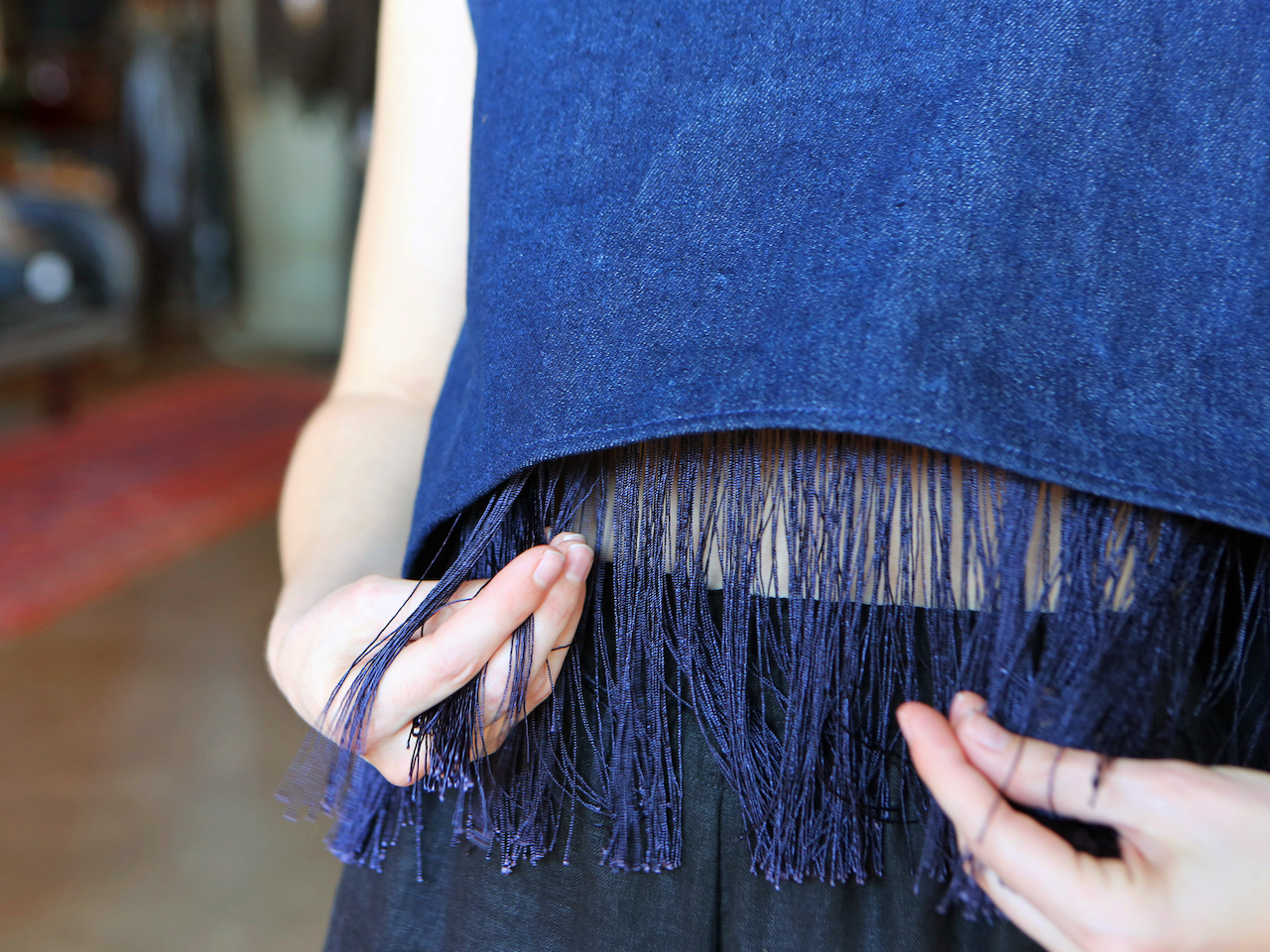 A closeup of the fringe on one of Nashville designer Ona Rex's tops.