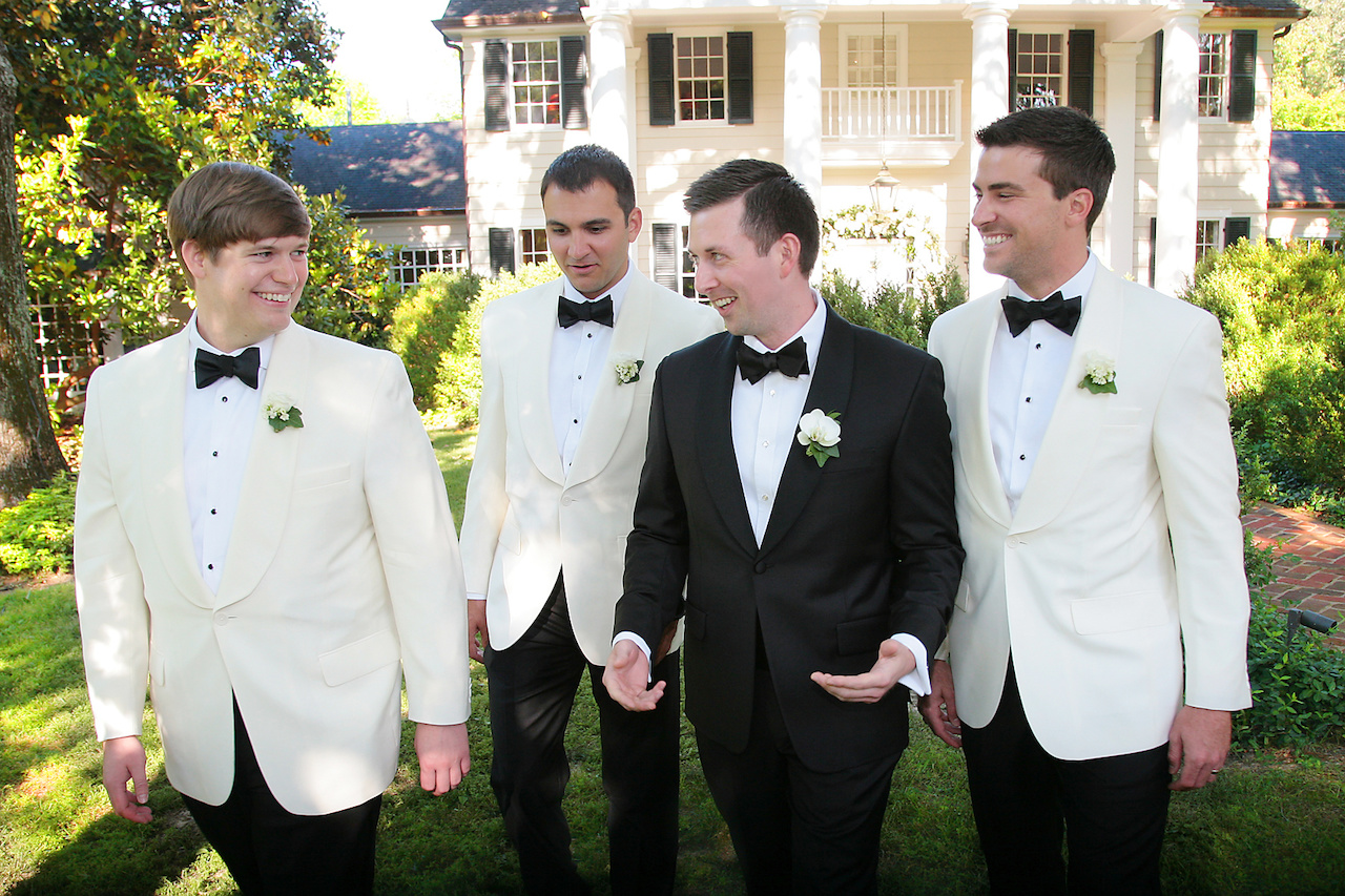Matthew had his tuxedo specially made for him at a trunk show, and one of the gifts to the groomsmen were the white dinner jackets they wore during the wedding, which separated them from Matthew's. His best man was his best friend Zach Harris. He had two groomsmen, his closest friends Nick Myers and Trey Bowling. Because they wanted friends and family to be involved, Matthew invited a group of about 10 guys to spend the day together.