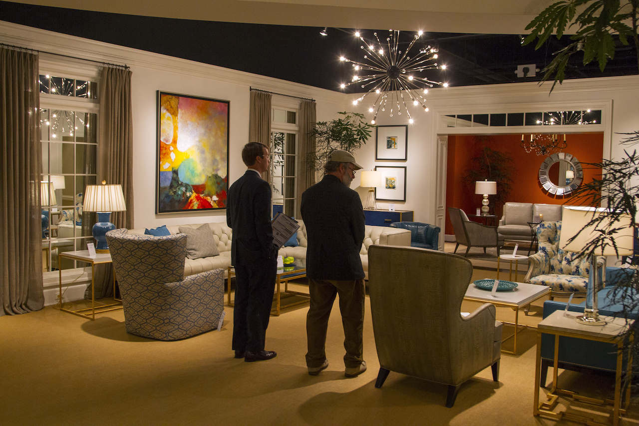 Patrick Flynn tours Michael through the Hancock and Moore showroom at High Point.