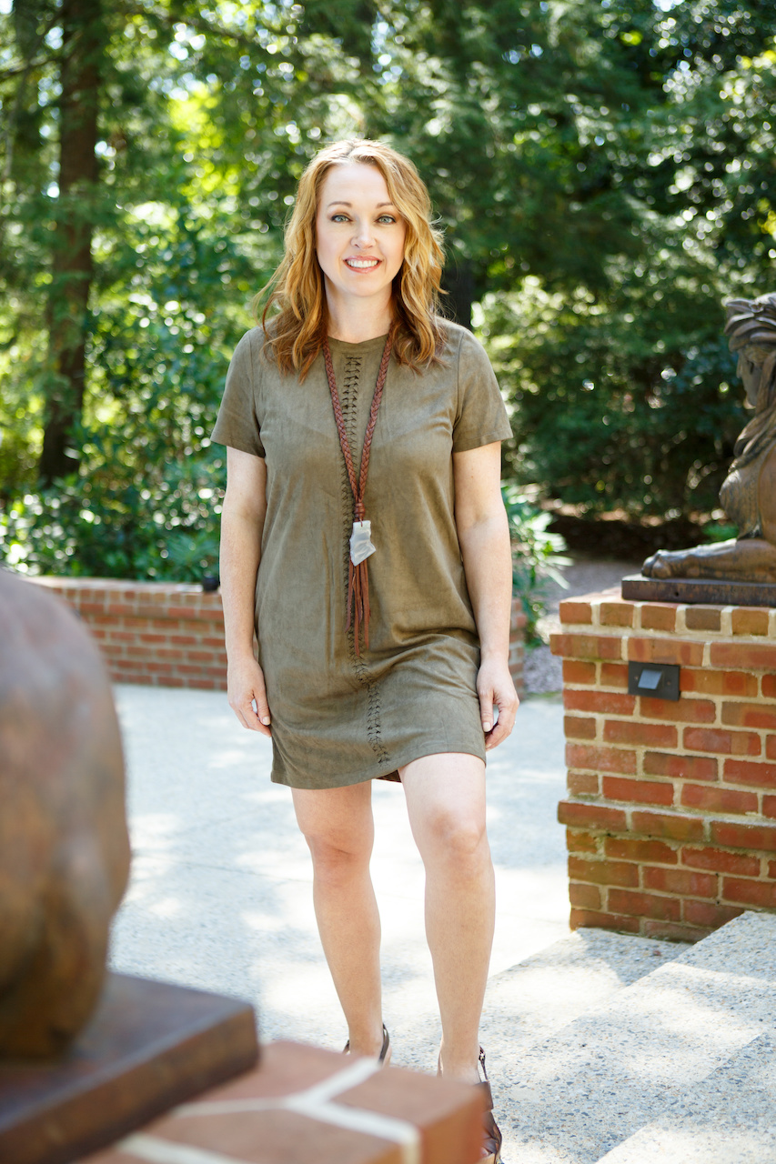 Melinda wears a short sleeve olive dress by KLD Signature, $74; necklace by local designer Gold+Stone. $190 and wedges by Antelope, $180, from Sorelle.