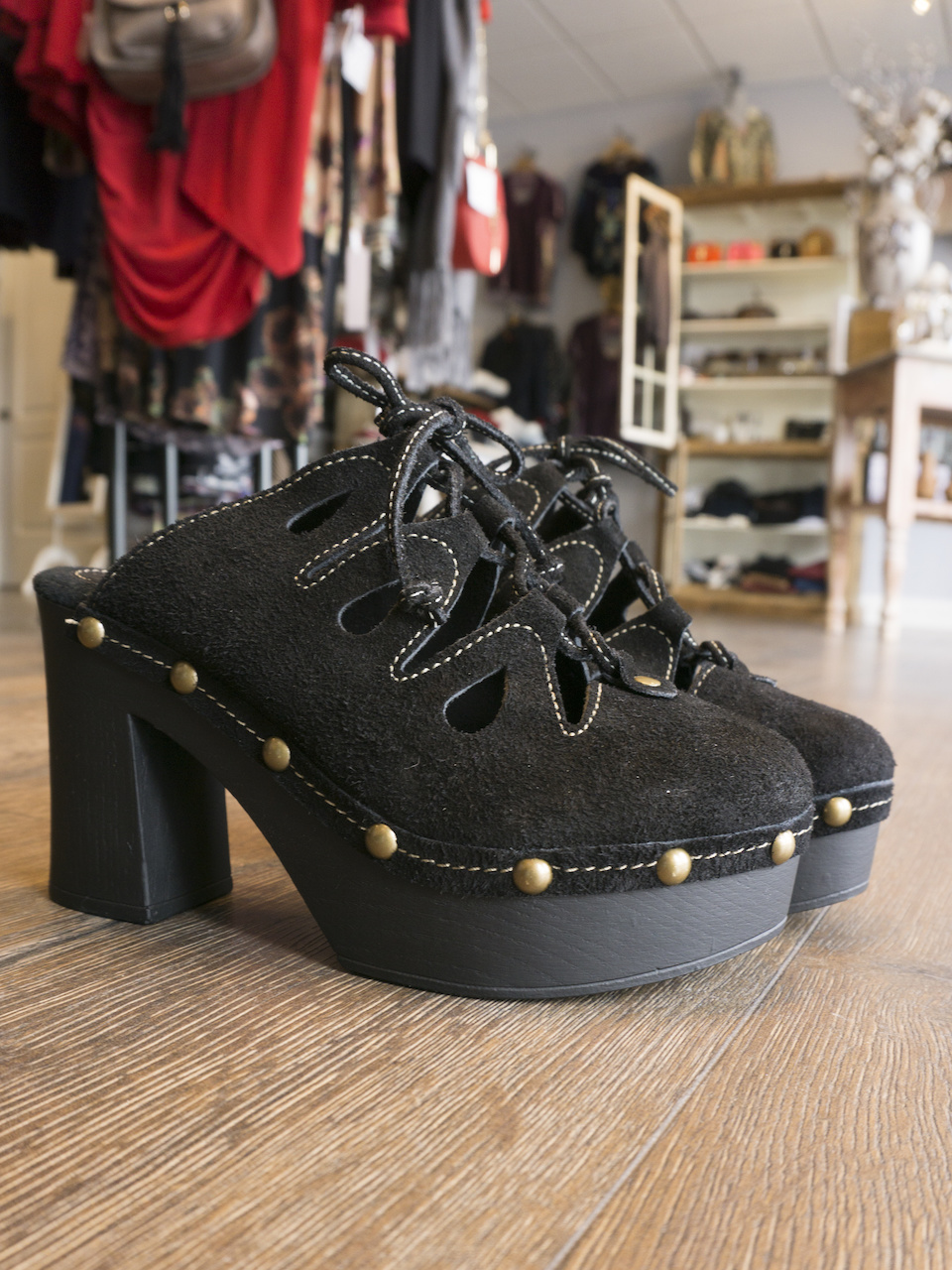 Pair the above shift dress with these super cool black lace-up clogs, $89, at Blu Boutique.