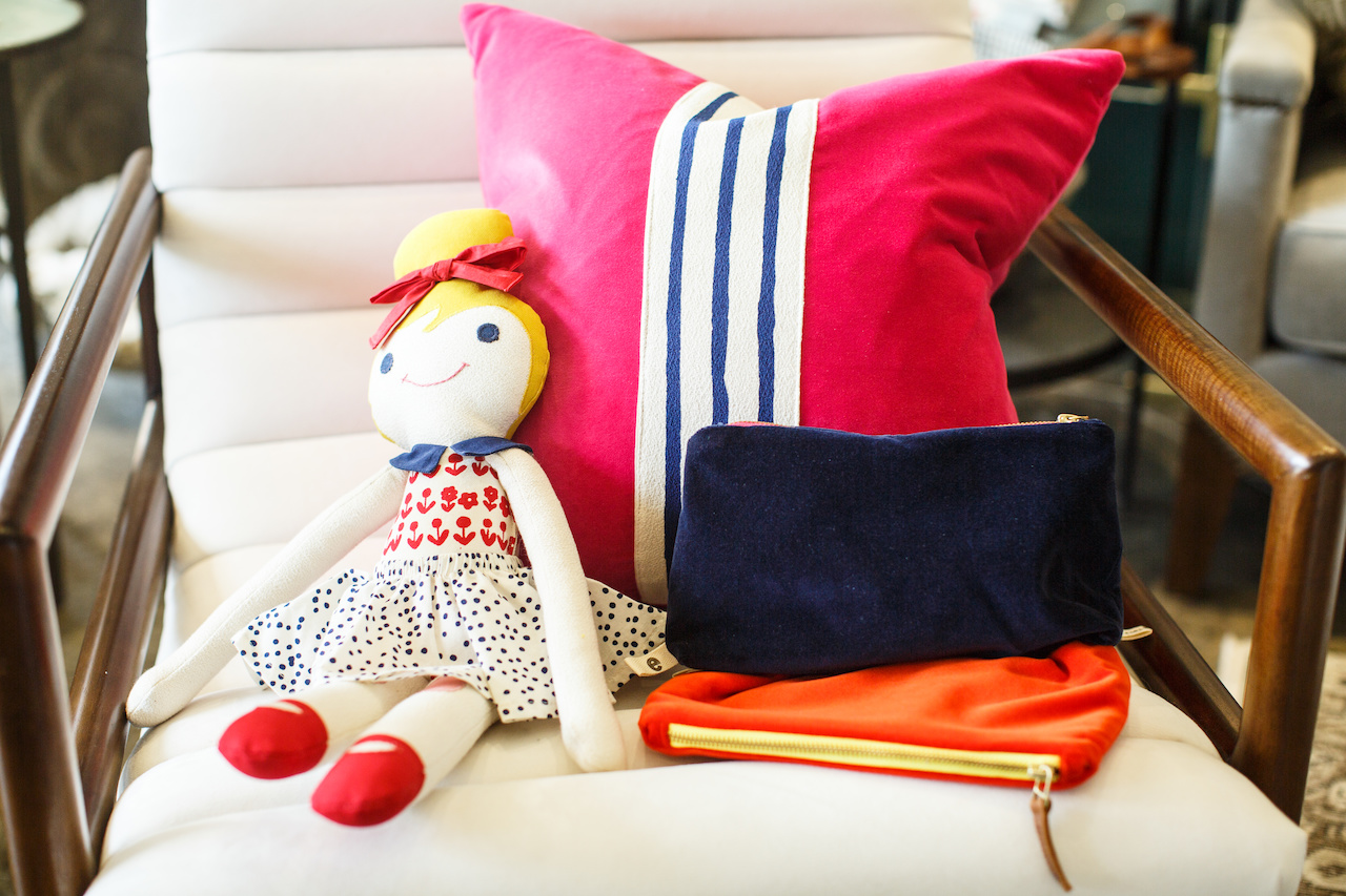 Pillows $122 and up; clutches $52 and up and dolls $136, at Spruce.