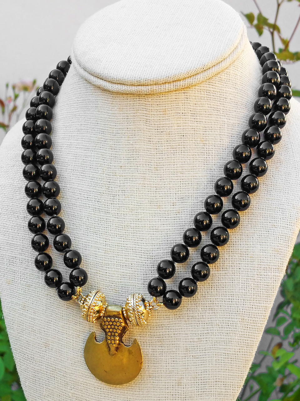 Clara Williams Company onyx necklace, $495, and the carved brass anchor, $325, at Estate Jewelers of Mountain Brook