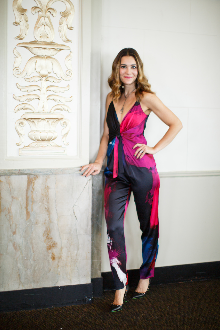 Colleen dazzles in this Diane von Furstenberg Rylen Jumpsuit $468; Beth Orduna necklace, $995 and Valentino pump with studs, $795 from Joseph