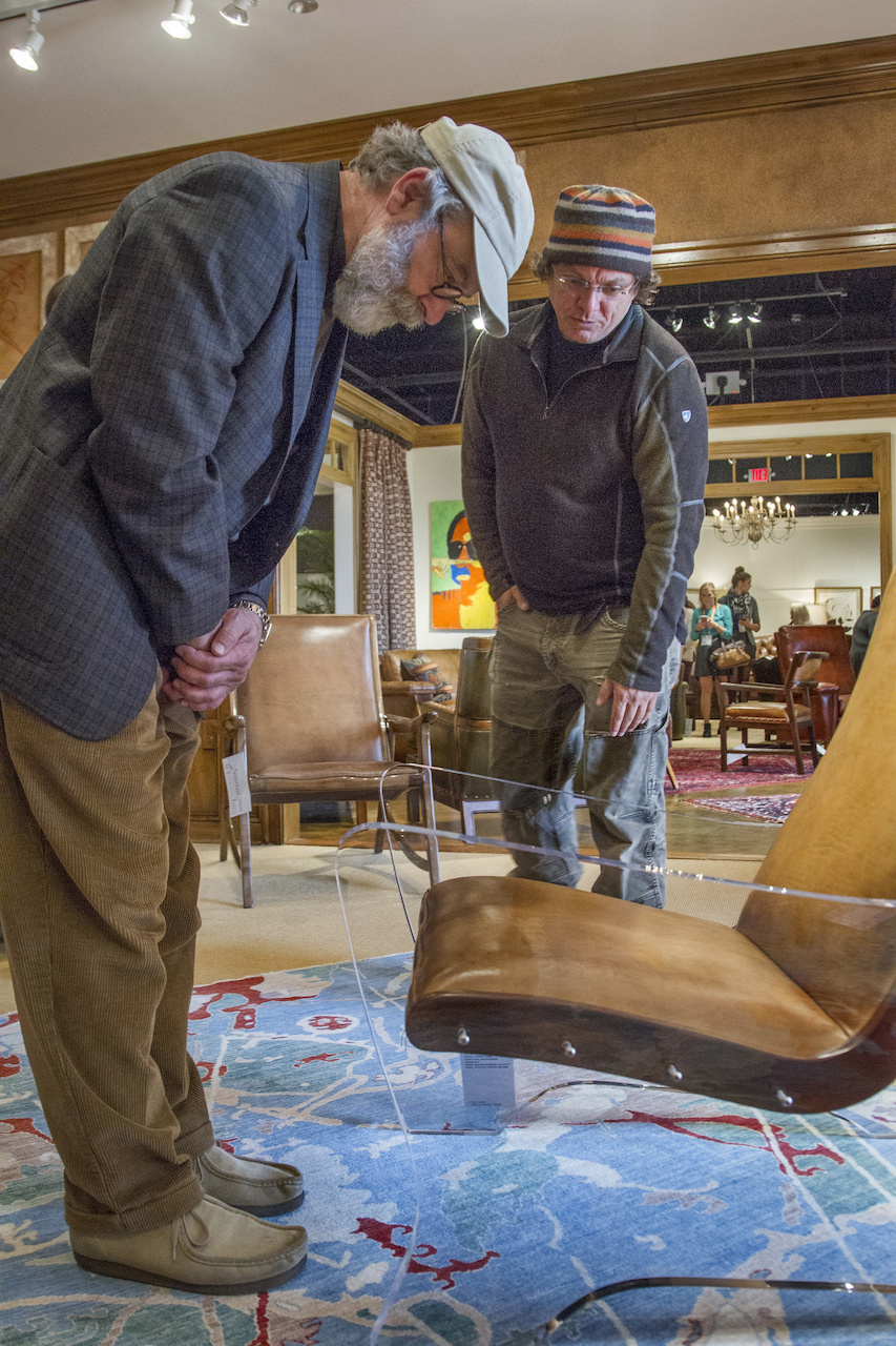 Allen tells Michael about his brilliant creation, this leather and acrylic chair he designed for Hancock and Moore.