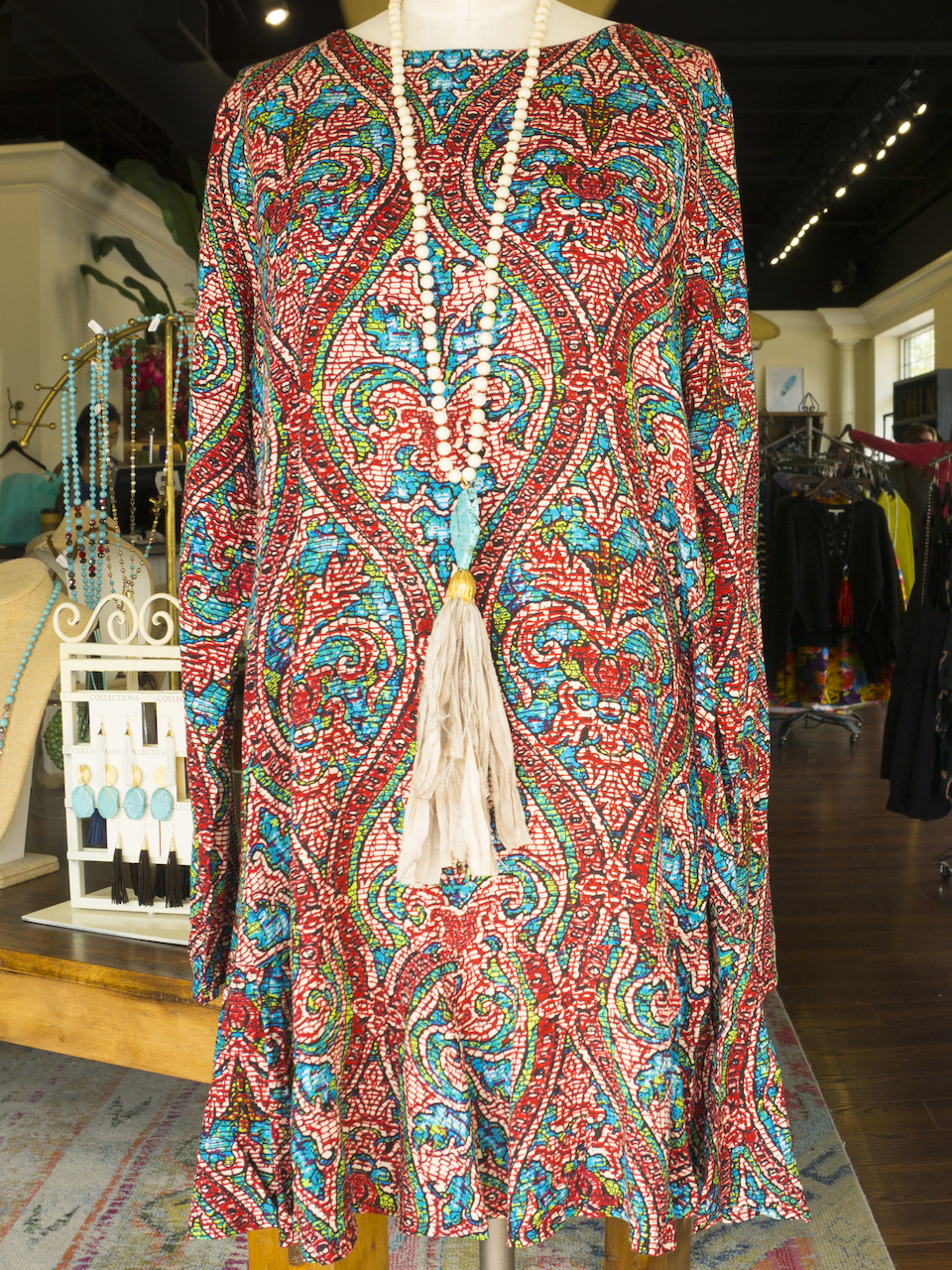 Multi-print dress, $54; Tassle Necklace, $68