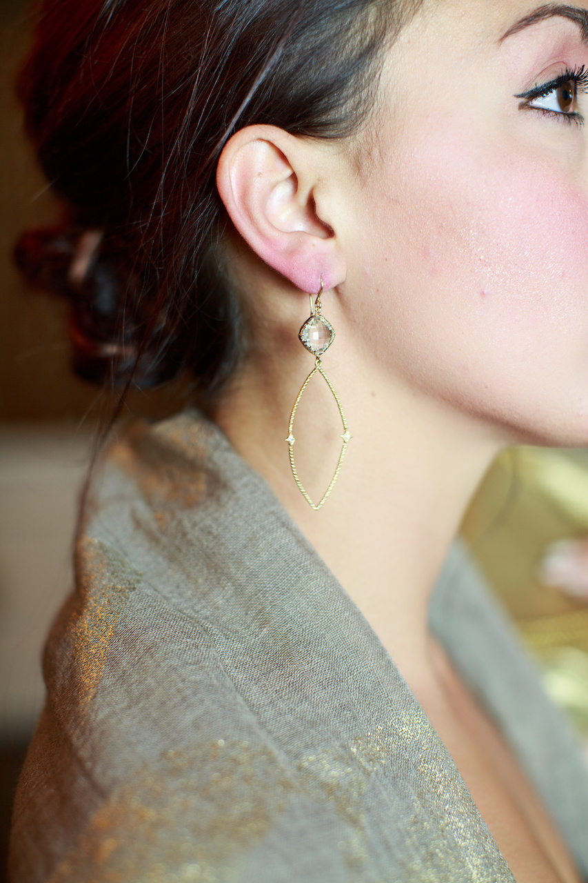 Understated elegance: Tolani taupe/gold wrap, $109 and Kim Gambrell earrings, $79, from Betty Hays.