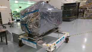 The ISS-CREAM payload was delivered to NASA's Kennedy Space Center in August 2015. The experiment is shown wrapped in plastic layers used to protect its sensitive electronics during shipment.  Image credit: University of Maryland Cosmic Ray Physics Laboratory (Click image to download hi-res version.)