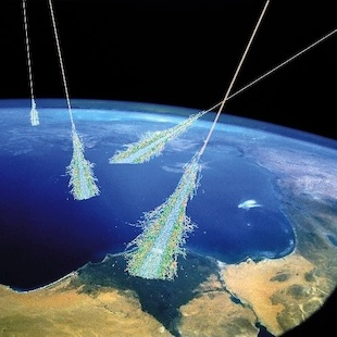 This artist's impression shows highly energetic cosmic rays hitting Earth's atmosphere, where they set off showers of secondary particles as they interact with air molecules. Image credit: Simon Swordy, U. Chicago/NASA (Click image to download hi-res version.)