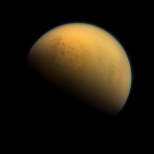 A new research paper describes a period more than 2.4 billion years ago, when Earth's atmosphere was filled with a thick, methane-rich haze much like Saturn's moon Titan, seen here in an image taken by NASA's Cassini spacecraft in 2013. Image credit: NASA/JPL-Caltech/Space Science Institute (Click image to download hi-res version.)