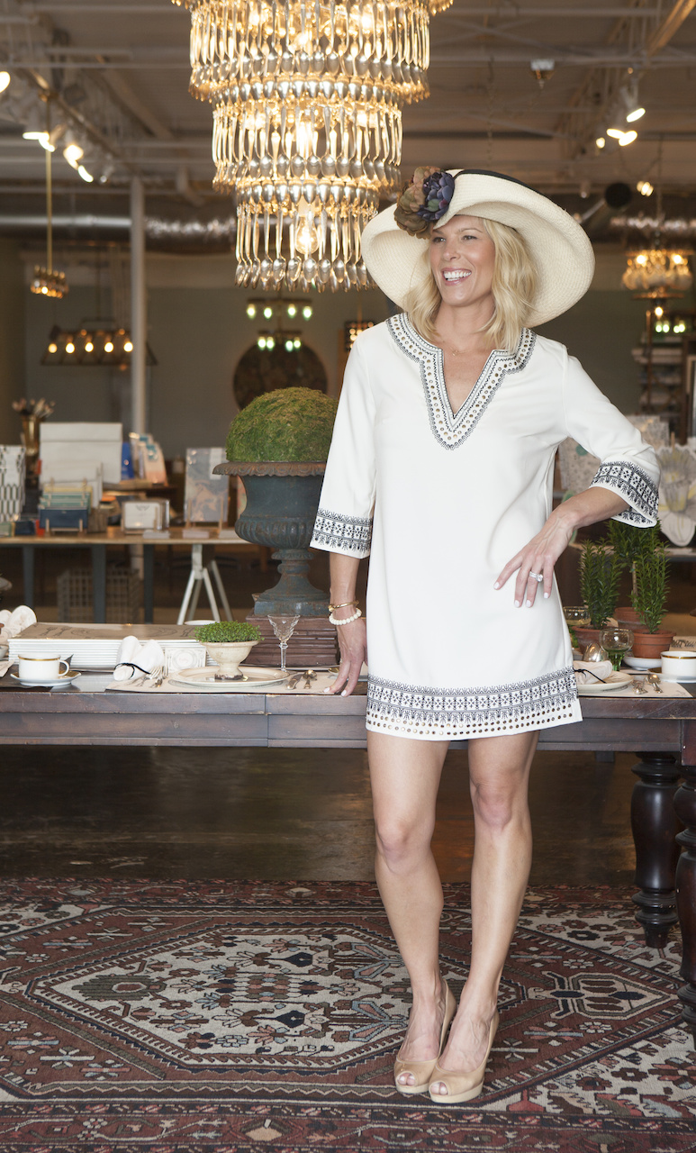 "We had to get this fabulous chandelier at Hester & Cook incorporated into a shot. Note that those are spoons hanging down! Landyn is in a tunic dress from <a href=""https://styleblueprint.com/nashville/guide/soca/"" target=""_blank"">SOCA</a>, available for $79.50. Rebecca paired the dress with a hat from <a href=""https://styleblueprint.com/nashville/guide/stacey-rhodes-boutique/"" target=""_blank"">Stacey Rhodes Boutique</a>, available for $299. Don't just think Steeplechase. This look works well beyond that one day! And, with the price of the tunic, this is the one you pack for the beach and double for your fancy cover-up, go short with the dress or wear over white jeans."