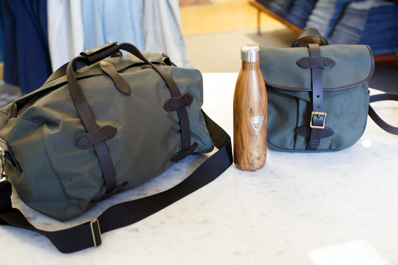 From Oak Hall, Filson small duffel, $265 and small field bag, $182; logo Oak Hall Swell bottle, $25.