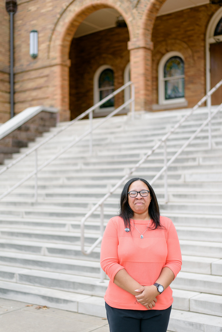 T. Marie stands before the steps of the 16th Street Baptist Church in downtown Birmingham.