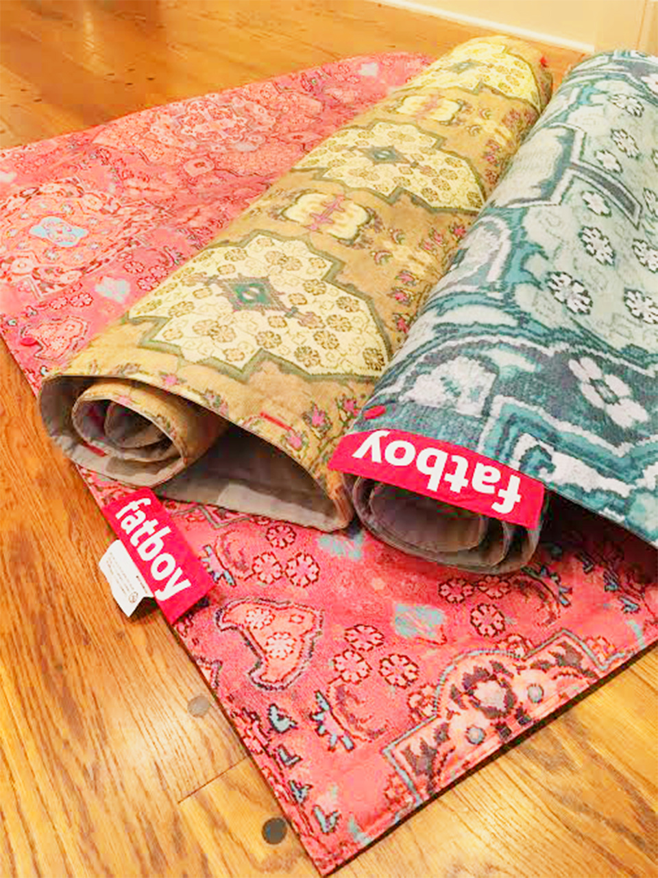Fatboy blankets, $179 each, at Paige Albright Orientals