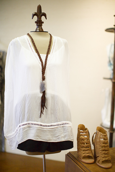 From Sorelle: Unstructured white silk top with camisole by Temp Paris, $68; black Lilla P. shorts with side pockets,$102; Dolce Vita lace-front, side-zip sandals, $190 and Gold + Stone braided leather necklace, $68.