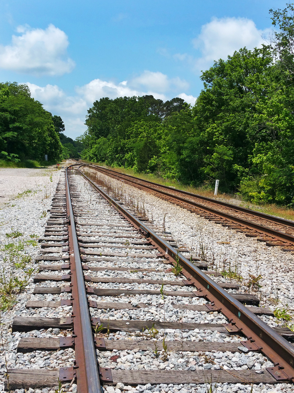 A view of the railroad tracks underneath a blue sky