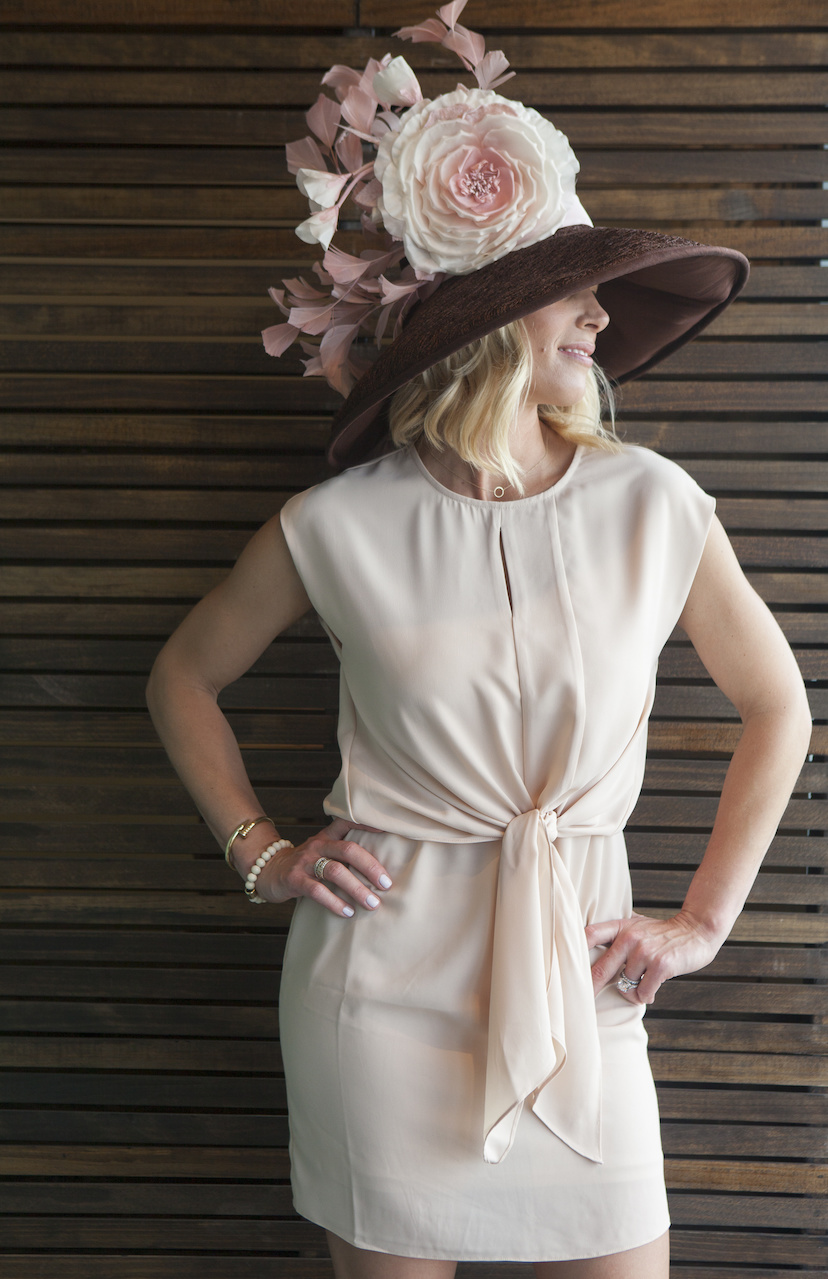 This hat had us all swooning. It's found at Stacey Rhodes Boutique for FILL IN. The dress is from SOCA for $68.