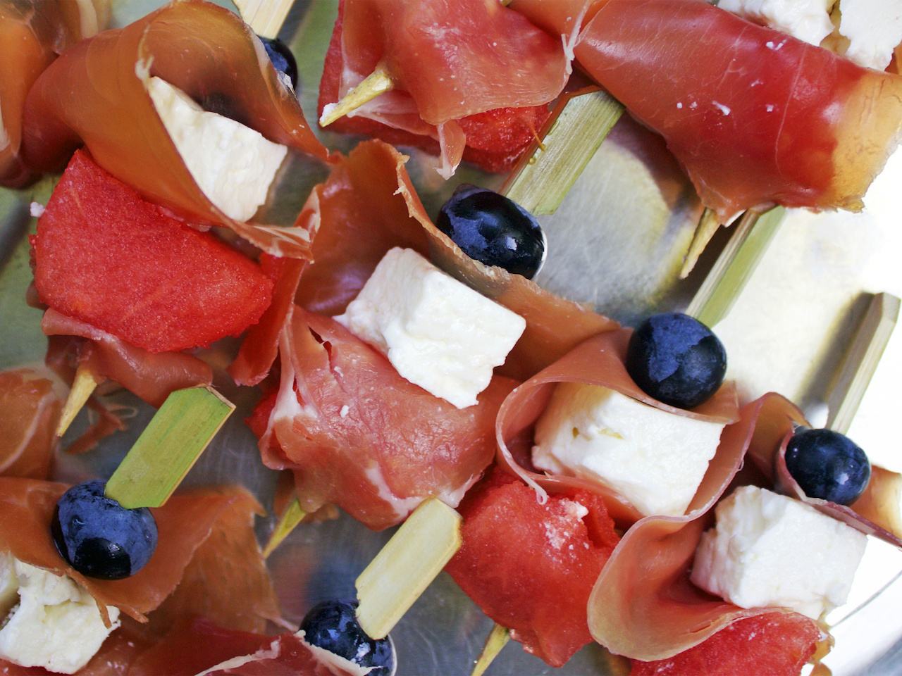 Proscuitto, feta, watermelon and blueberry on this festive skewer.