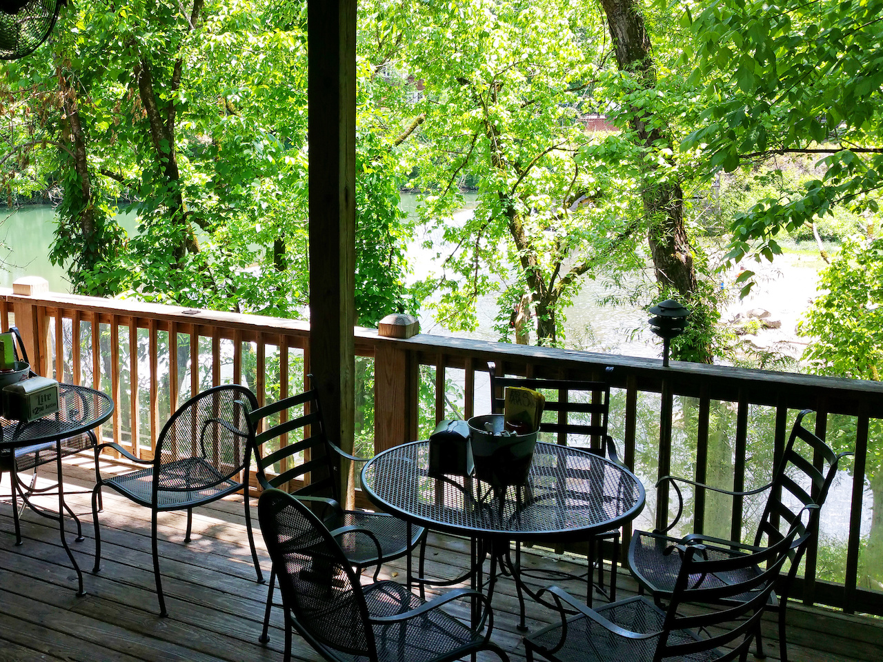 The partially covered patio at Papa Saia's overlooks the Buck Creek falls through a gentle tapestry of leaves.