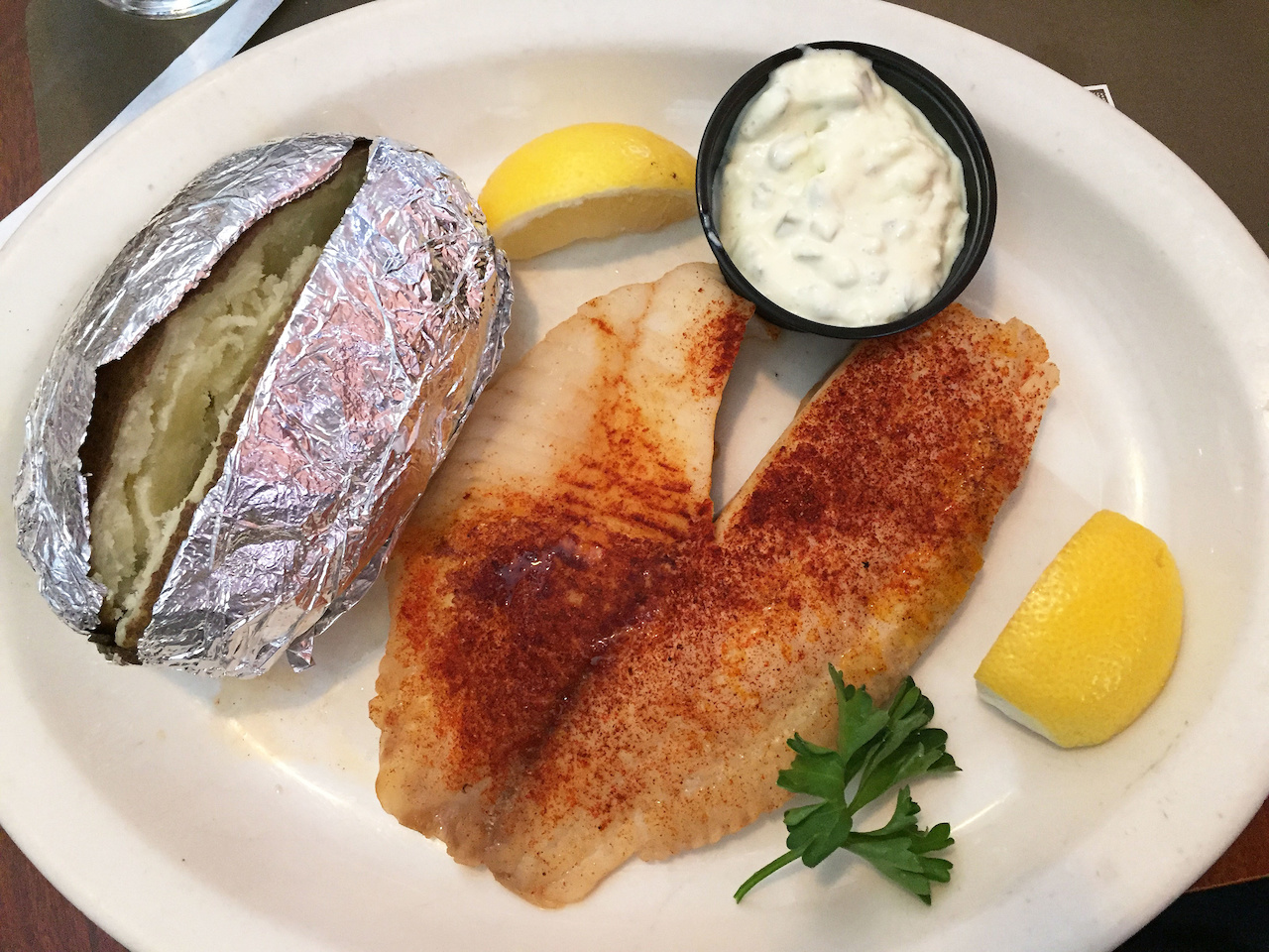 The tilapia is so good and comes with a choice of two sides: I went with the baked potato and the cucumber salad (which was devoured in under 1 minute).