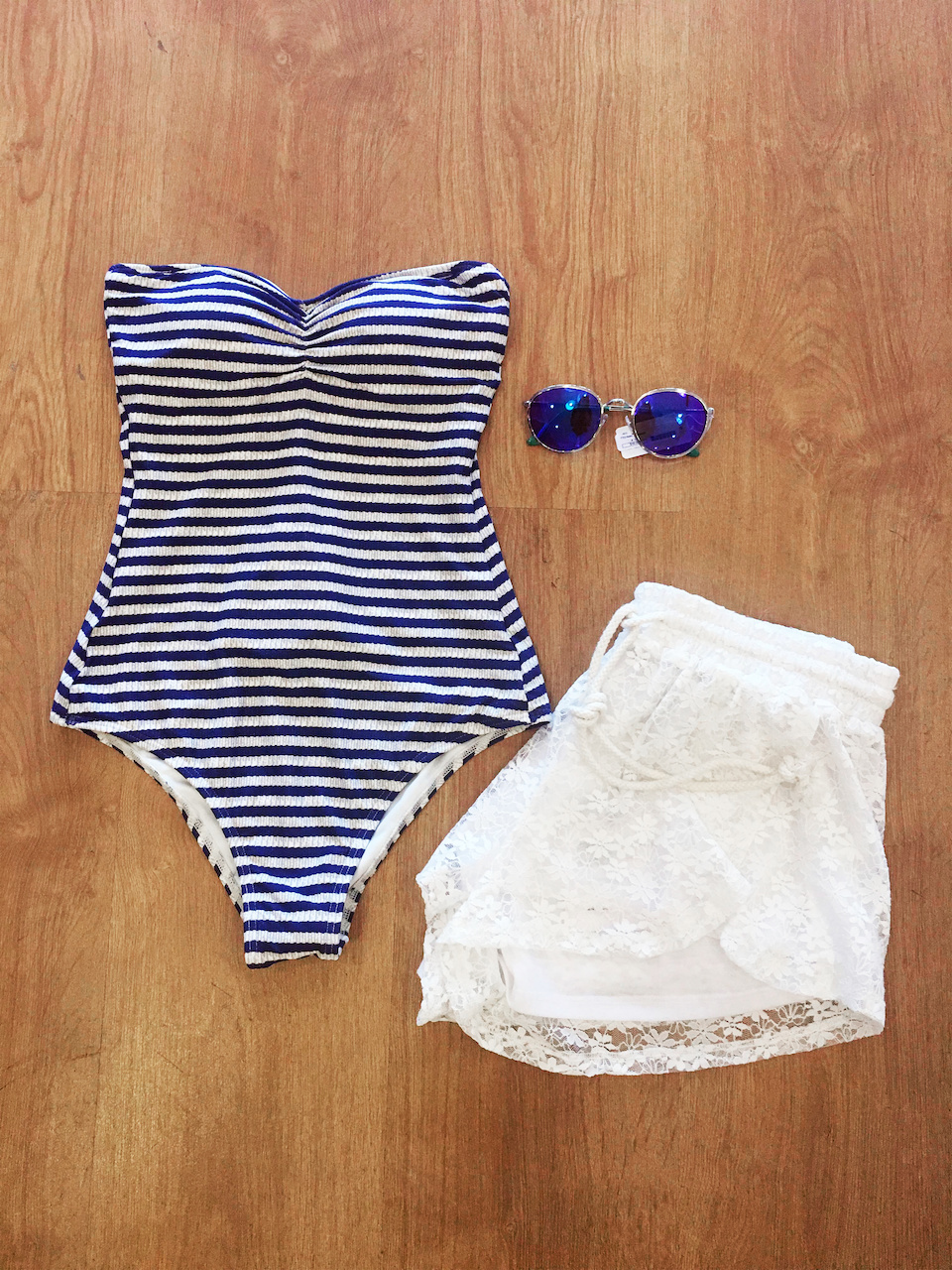 From Snap: Billabong stripe bathing suit, $80; white lace shorts, $68; TTO Retro Sunglasses, $16