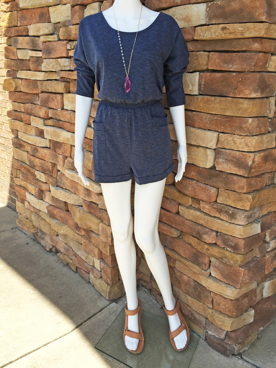 From Rogers Trading Company: denim knit romper, $49.99; Teva tan leather sandal, $89.95