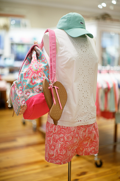 From Vineyard Vines: Pink shell-patterned shorts, $98; sleeveless eyelet top, $98; pink bow flip flops, $49.50; sea mist logo hat, $28 and a striped print day pack, $98.