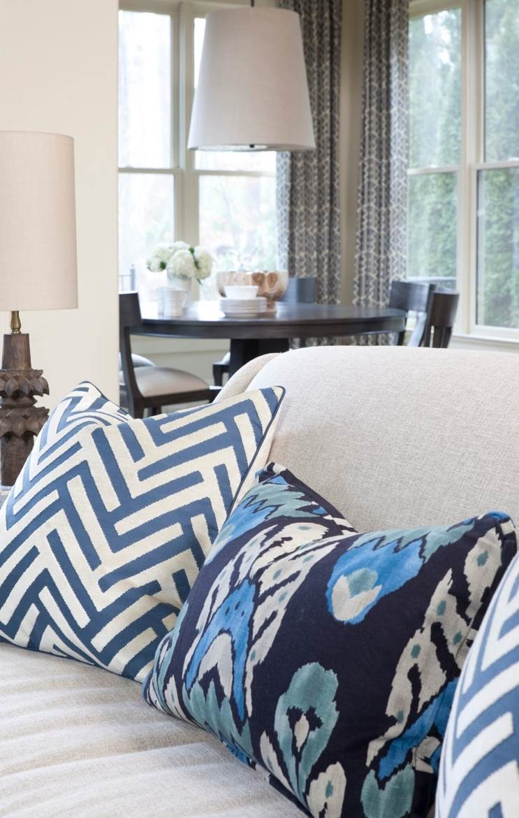 Delegating patterns to easy-to-replace accessories such as pillows allows more opportunities to change the look.