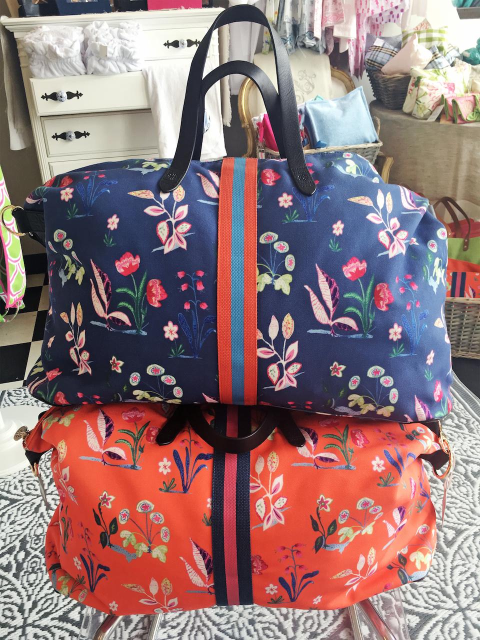 Pomegranate Inc. weekender bag, $170 each, at B. Bayer & Co. Monogramming & Gifts