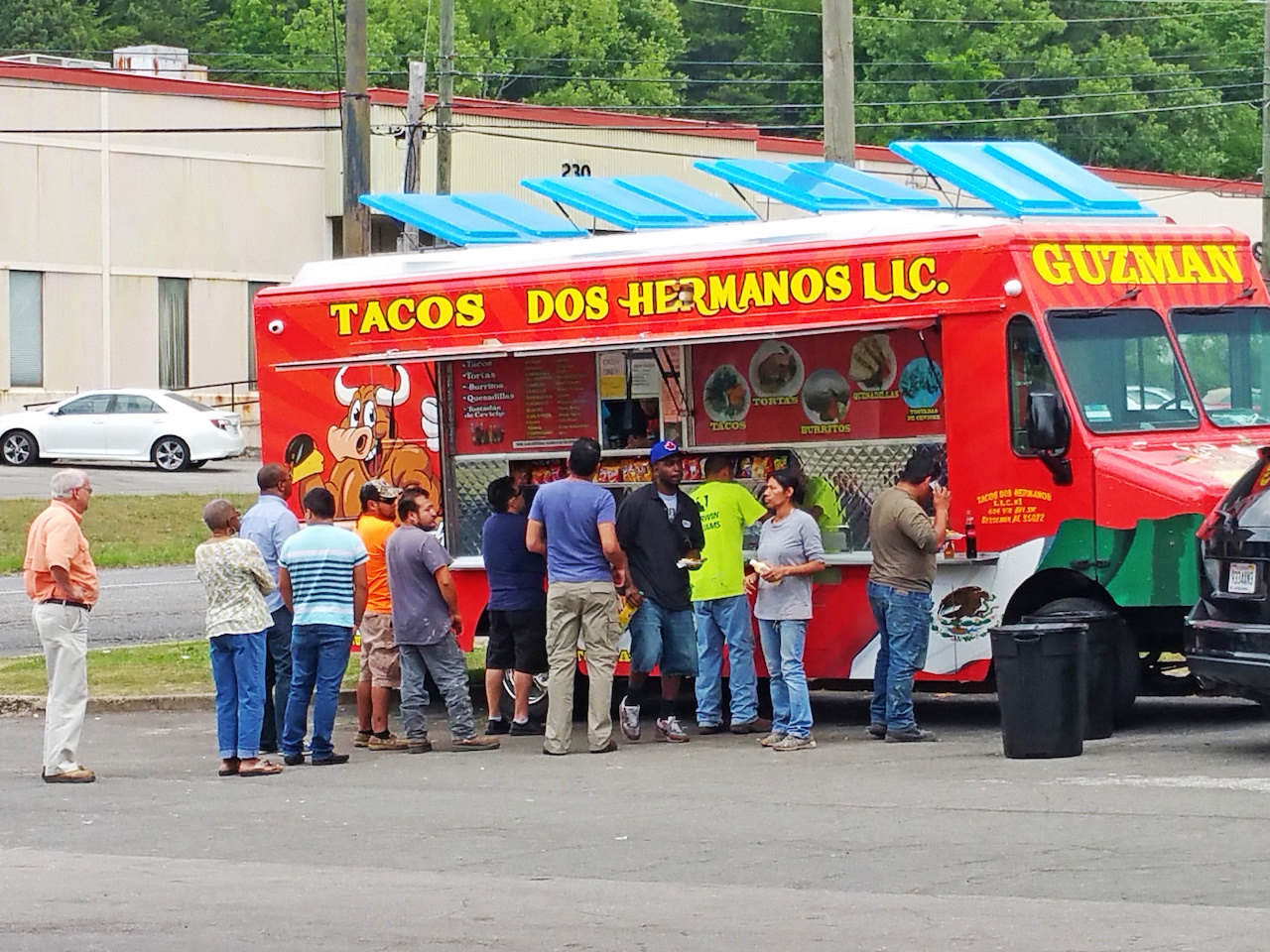 All walks of life can be found in line at the Dos Hermanos taco truck.