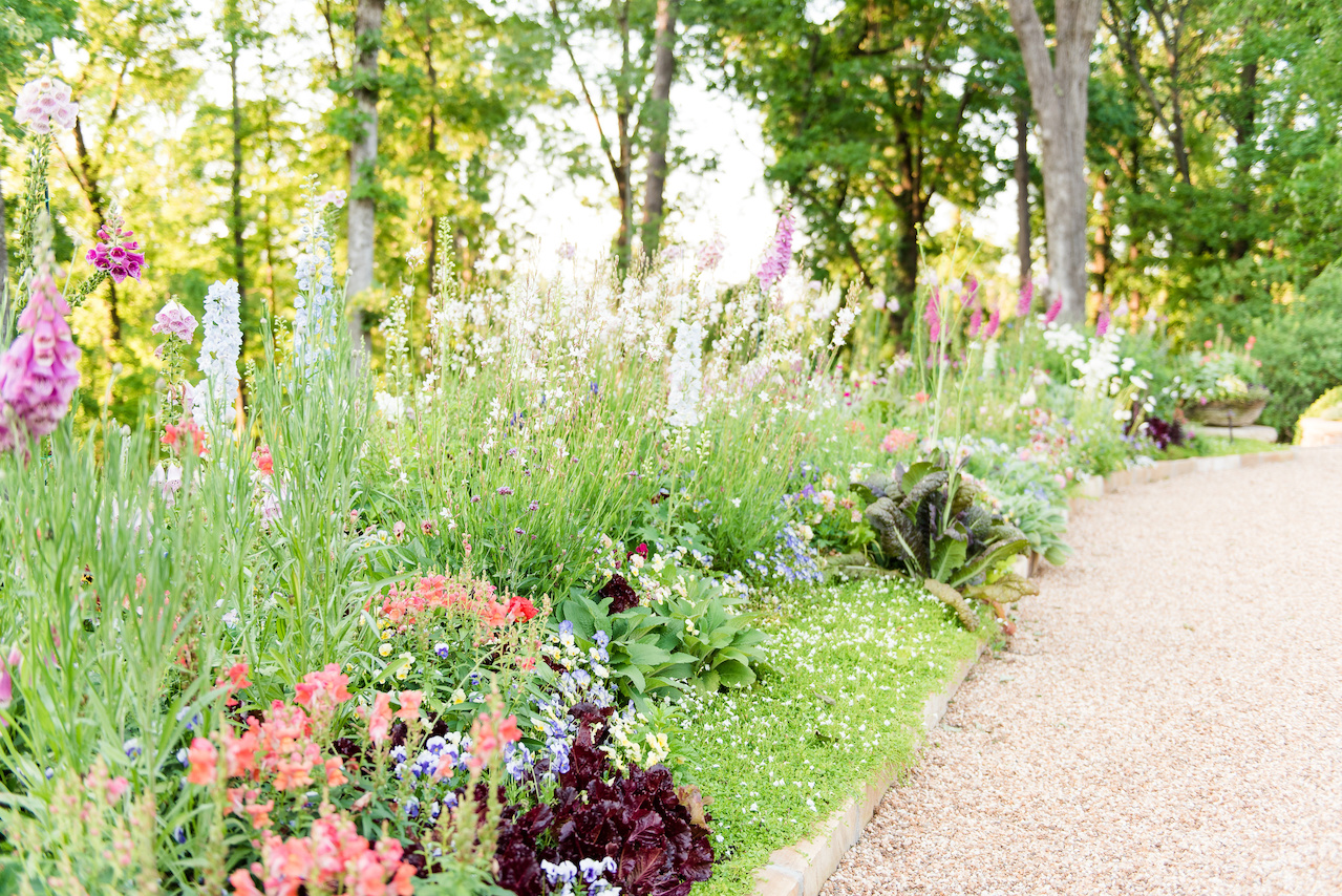 Pratt Brown Landscape keeps the flower border lush and luxurious with a variety of plants and flowers.