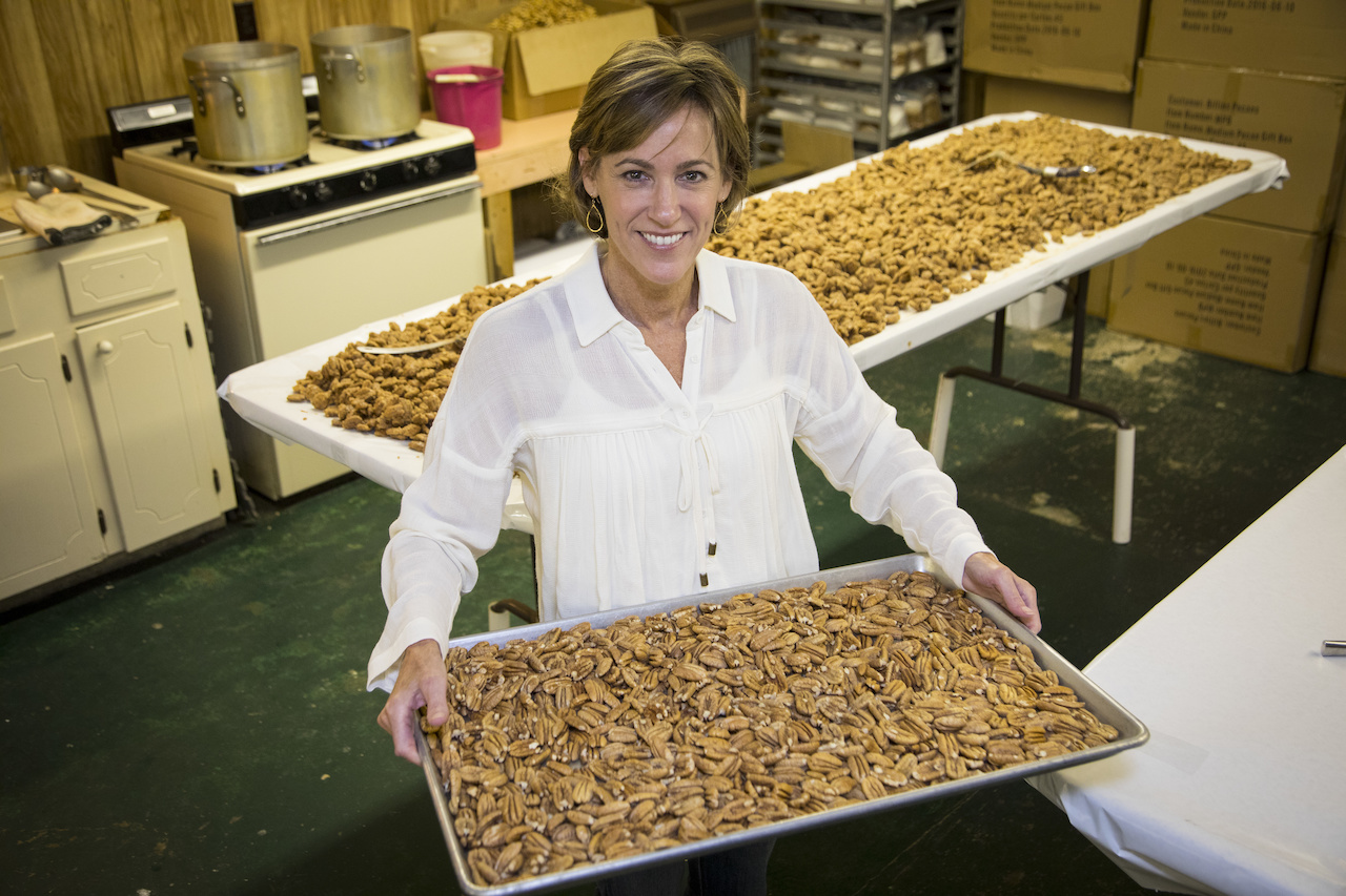 Stacy Crenshaw carries on her mother-in-law's business, Billie's Pecans and More, in Crenshaw, MS. See the four-burner stove in the background? It's the original farm stove Billie used in the 1960s to maker her delicious spiced pecans!