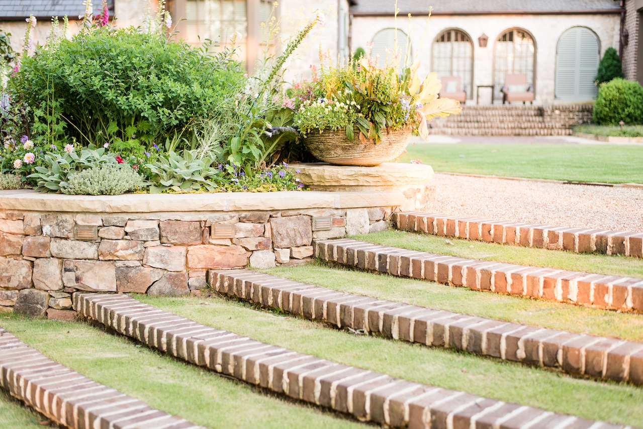 """""""The radial lawn steps with brick risers that cascade through the flower border down to the lower lawn are softer on the eye,"""" says John. """"They merge architecture into the garden in an elegant way."""""""