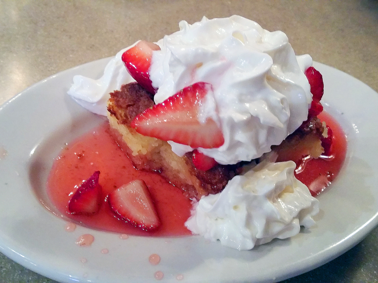 The strawberry shortcake is a seasonal fave at The Bright Star. Served with fresh strawberries and homemade whipped cream atop a rich, dense to-die-for pound cake, this is an unforgettable dessert.