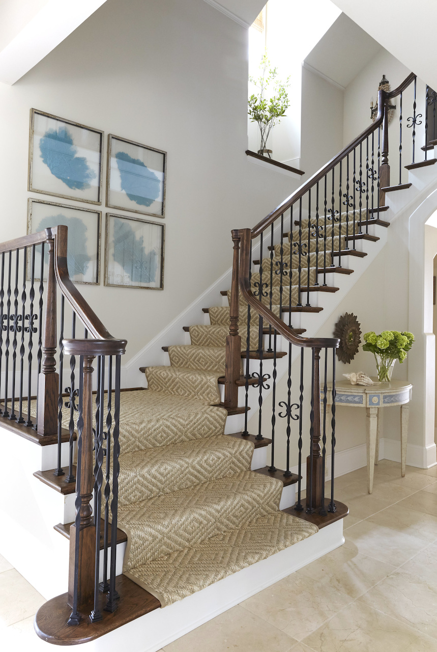 """Libby used a diamond sisal runner for the stairs in this beach house foyer. """"I love using natural fibers in a setting like that,"""" she says."""