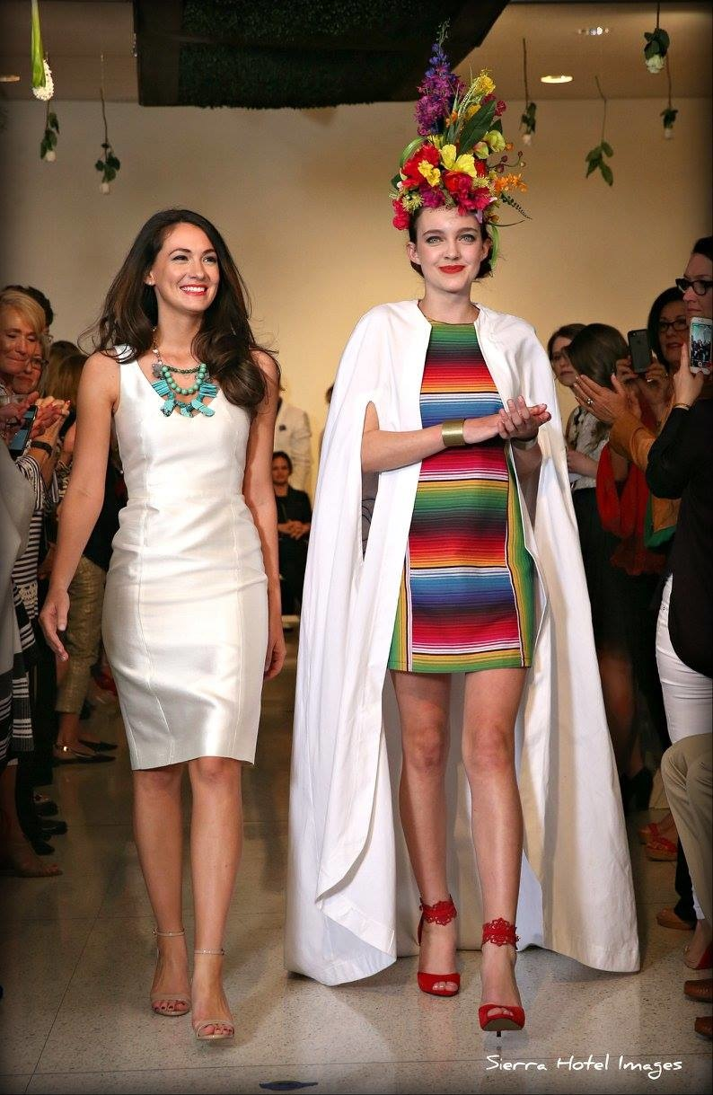 Designer Tara Skelley, left, walks the runway with one of her models.
