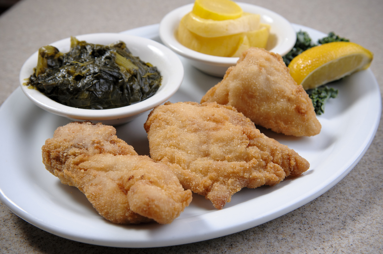 A classic sight at The Bright Star — fried fish, collards and squash! Image: Nik Layman