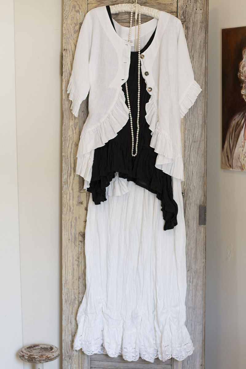 From Loudean's: https://www.facebook.com/pages/Loudeans/169579856389514 Ruffled linen skirt, $166; Crinkled linen tank, $186; White linen jacket, $186; Pearl necklace, $75
