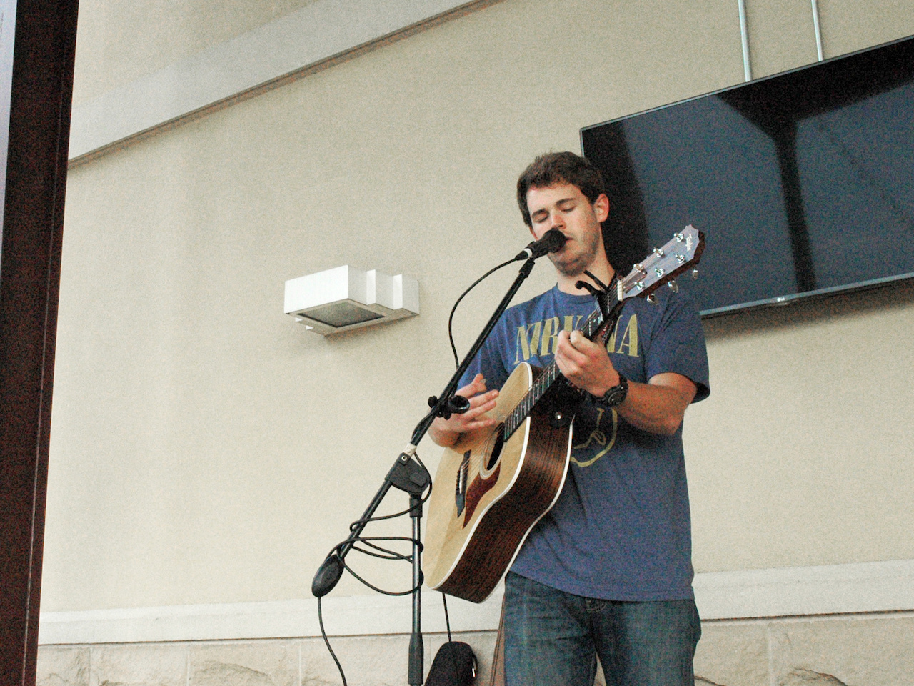 Local musician Conner Patrick serenades patrons before the sun sets.