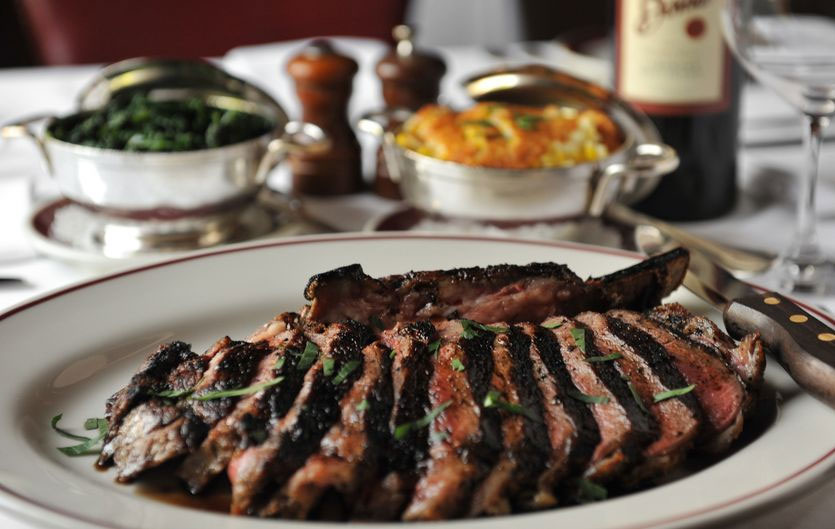 "There's nothing better than enjoying fine food, like that of Bone's. Here's a bone-in ribeye (for two), served with corn pudding and spinach. Image: <a href=""http://www.beckysteinphotography.com/"" target=""_blank"">Becky Stein</a>/<a href=""http://www.ajc.com/"" target=""_blank"">AJC</a>"