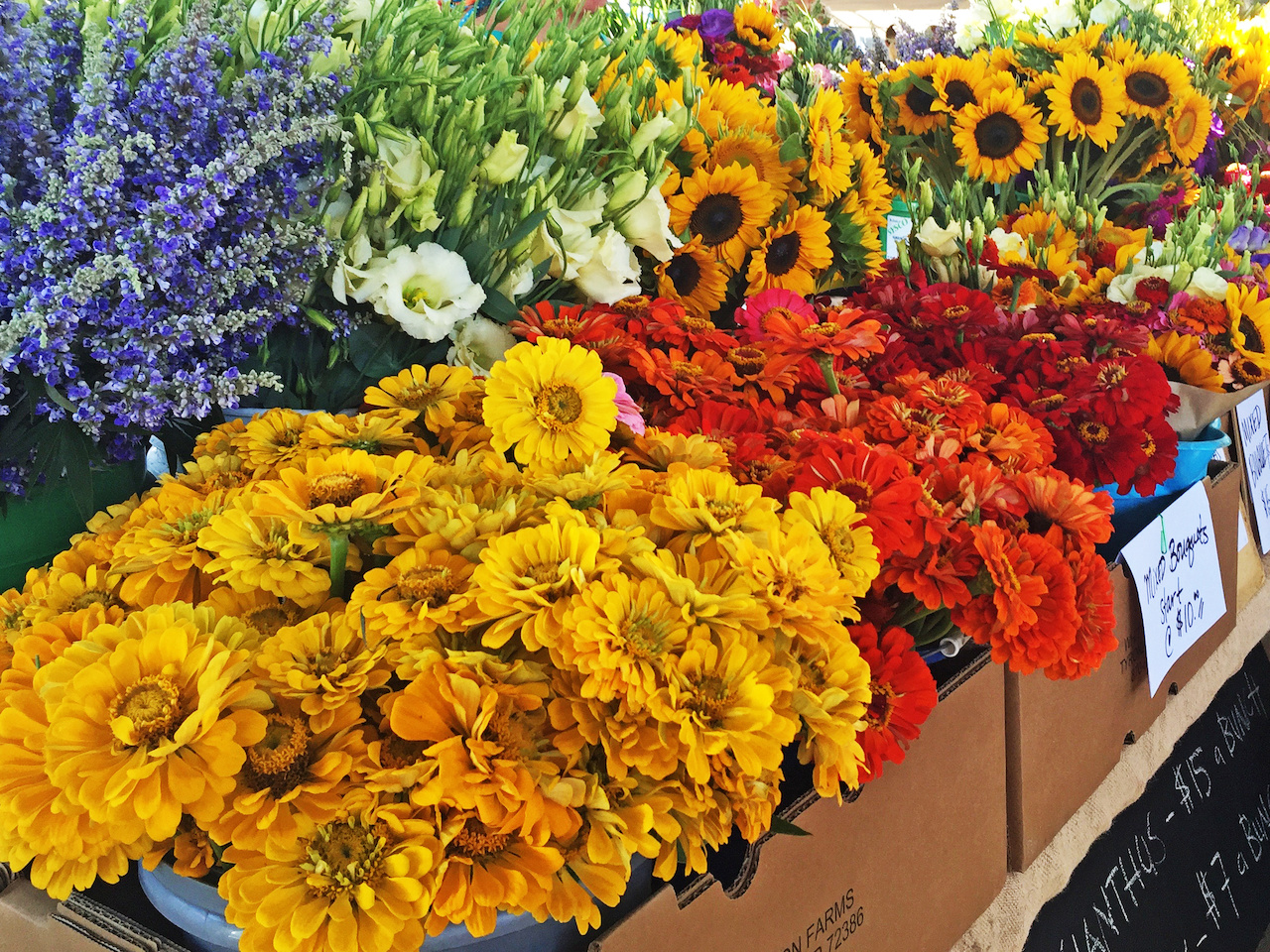 A CSA box may include flowers, in addition to vegetables or other products produced at the farm.