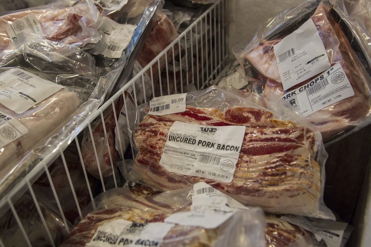 The meat case at The Curb is full of meats from Winchester Farms...
