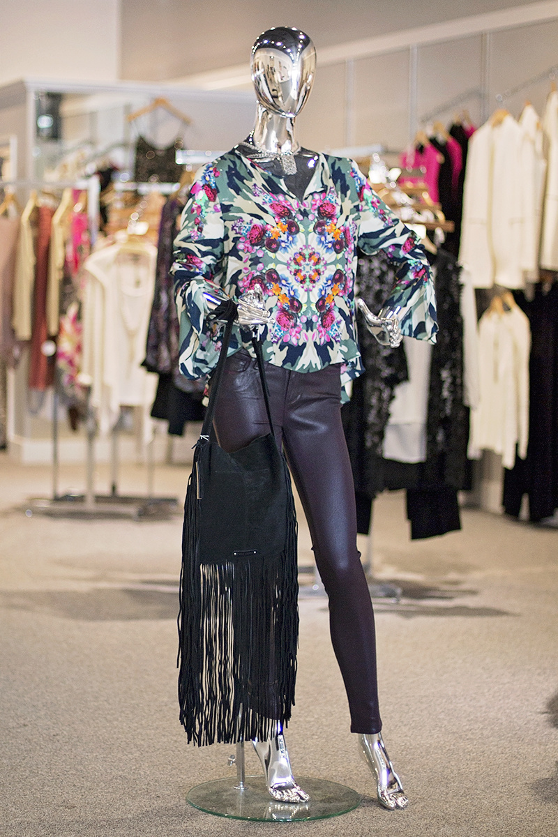 From Heather: Camouflage and kaleidoscope floral print silk top from Nicole Miller, $275; Paige luxe coated skinny jeans in wine, $220; Stevie suede fringe bag, $198; Pindi House mixed metals 1940's shoe clip necklace, $92