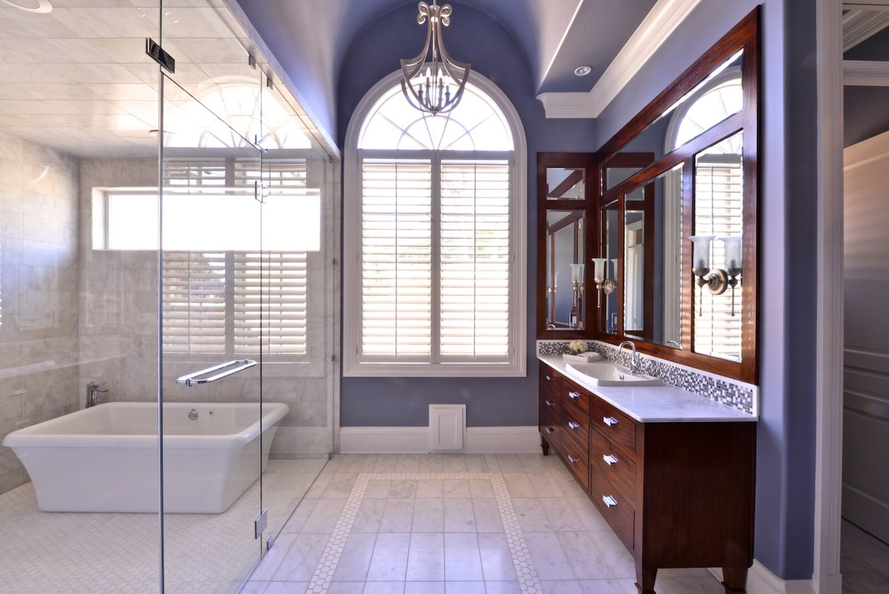 """Custom vanities have a furniture-like look in the master bath. The designer combined the shower and tub into one spa-like """"wet room."""""""