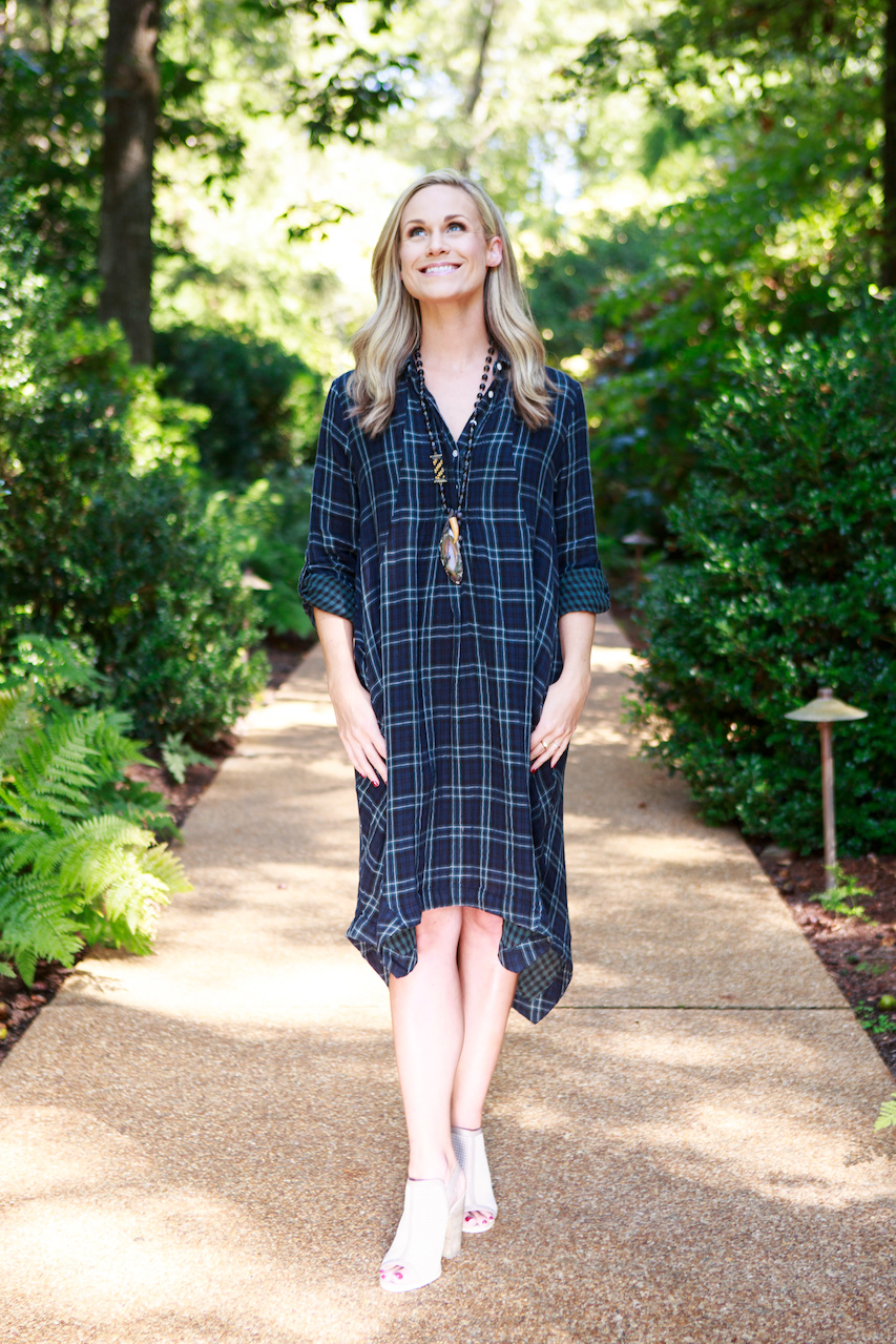 Ellie wears a plaid dress with contrasting check lining, $218, and a Myrna Halpern Necklace, $290, from Kittie Kyle