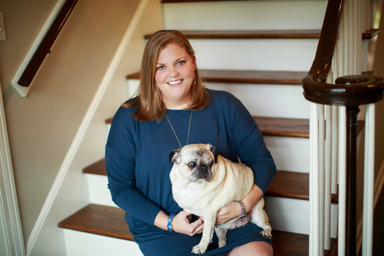 Whitney Luckett, founder of Luckett Media with Boots, her rescue pug.