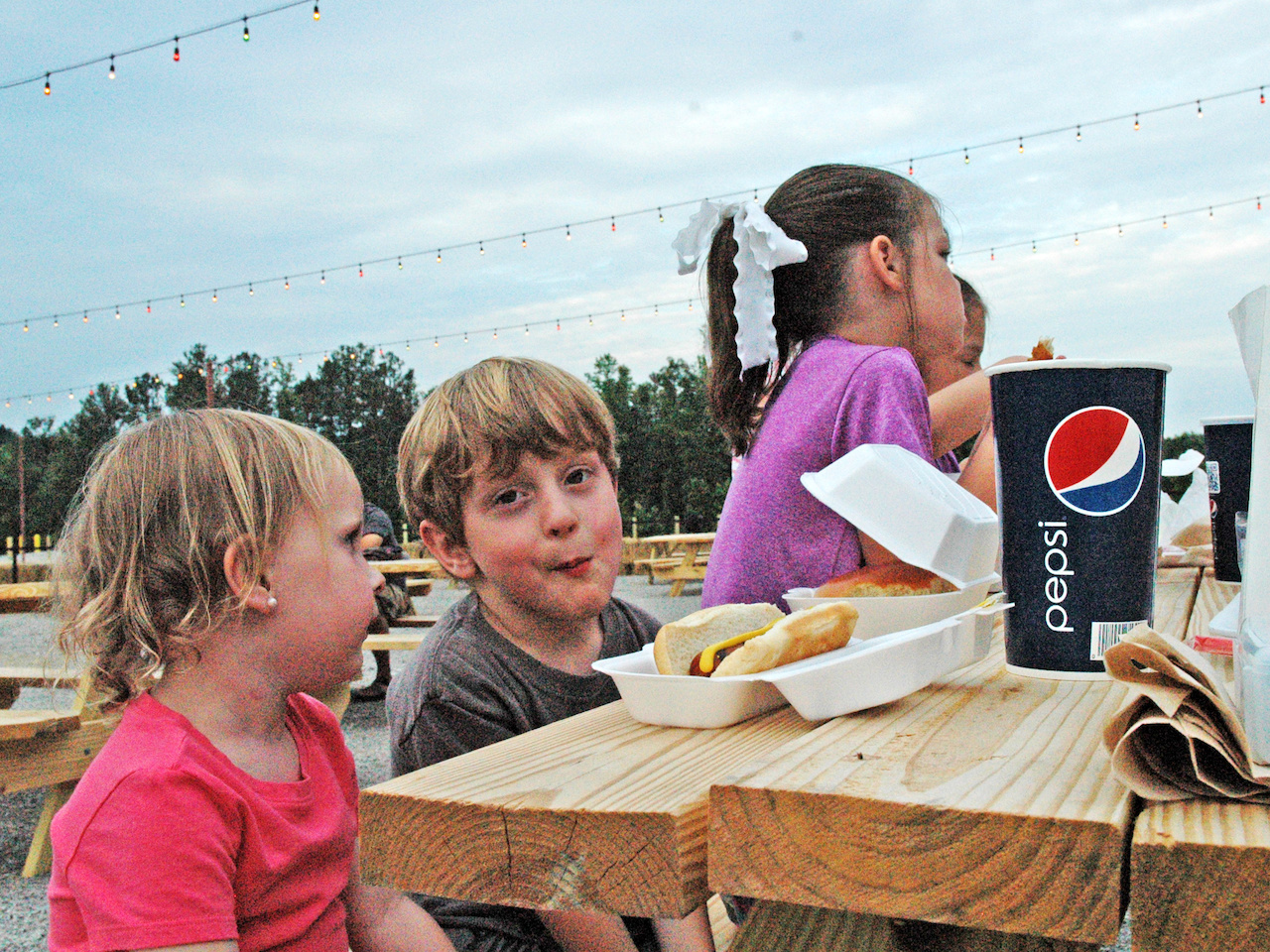 Adorable kids fuel up for the evening's movies and fun!