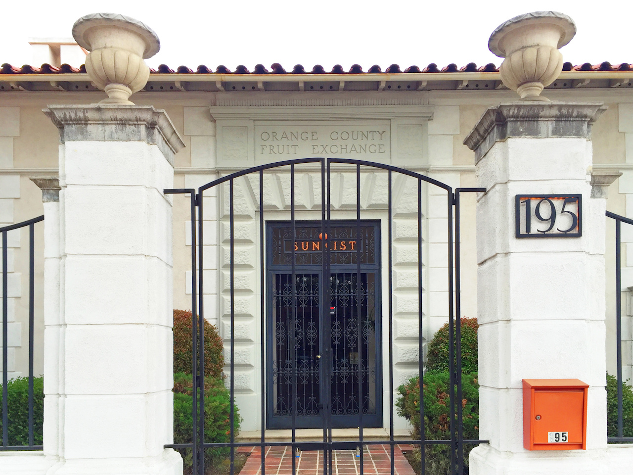 The gorgeous old Orange County Fruit Exchange at 195 Glassell Street in Old Towne Orange is now the Exchange Art Gallery, which is generally open from noon to 5:00 p.m. on Friday through Sunday, if there is an art show. If the gate is open, the gallery is open!