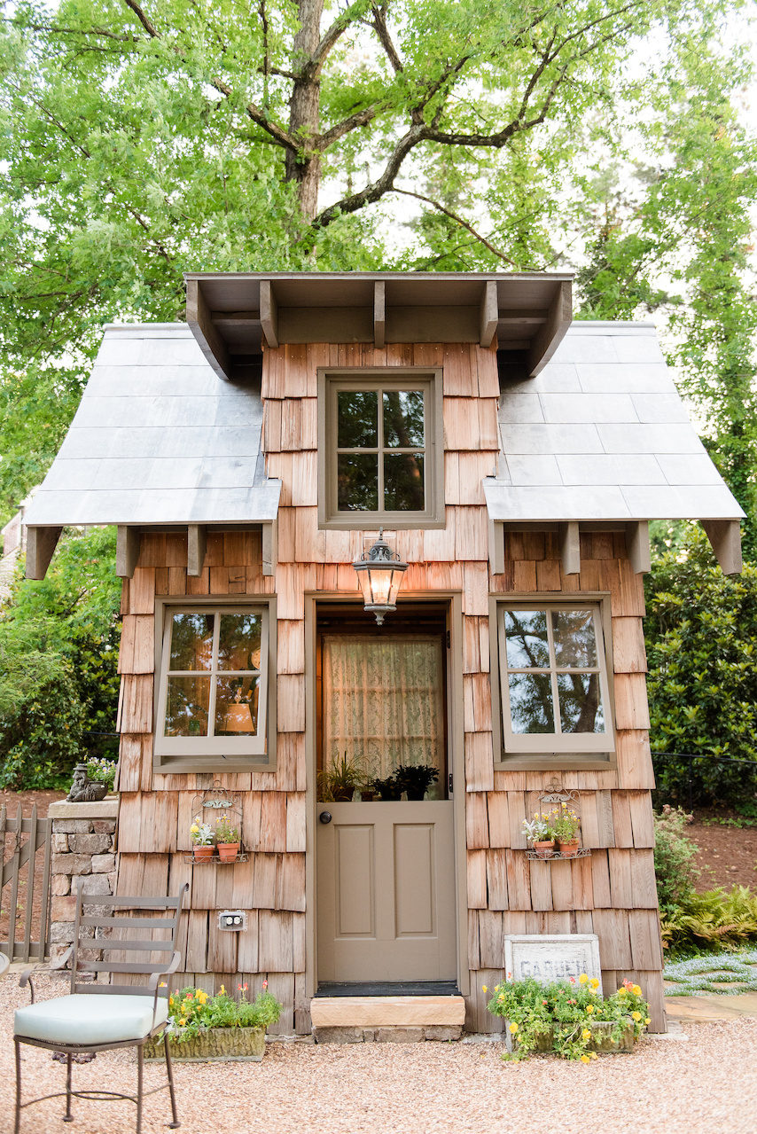 The homeowner, an avid gardener, saw a gardening cottage online and fell in love, so John worked her dream gardening hut into the landscape.